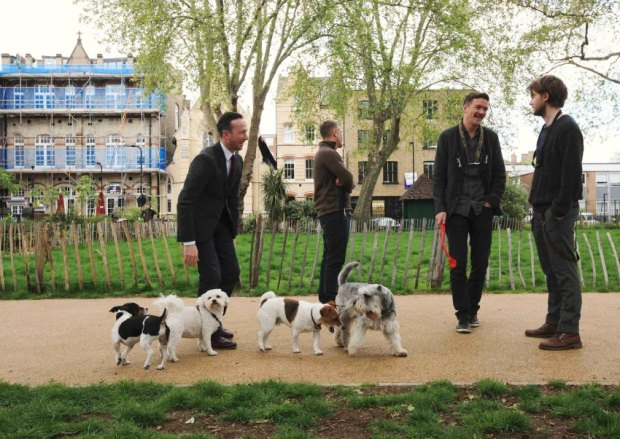 Residents walk their dogs in Hoxton Square, east London